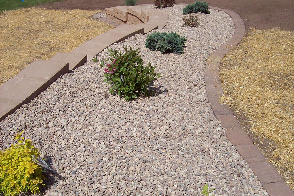 retaining wall with stone and bushes
