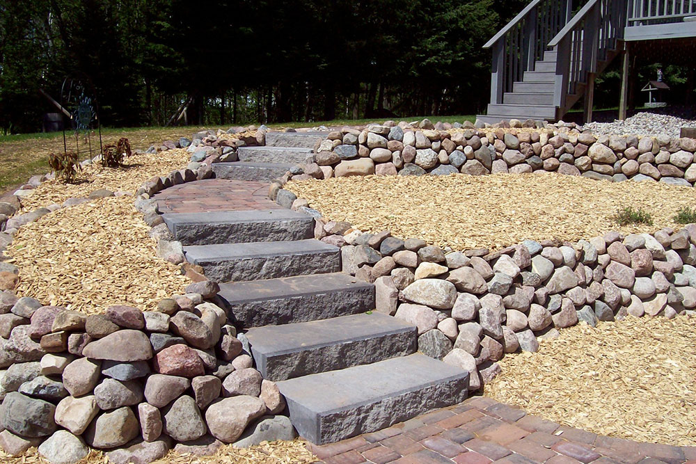 stairs with stones and landscaping