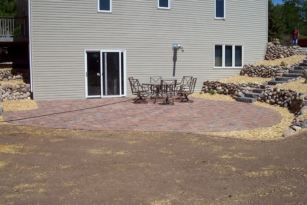 backyard patio with pavers and retaining wall project